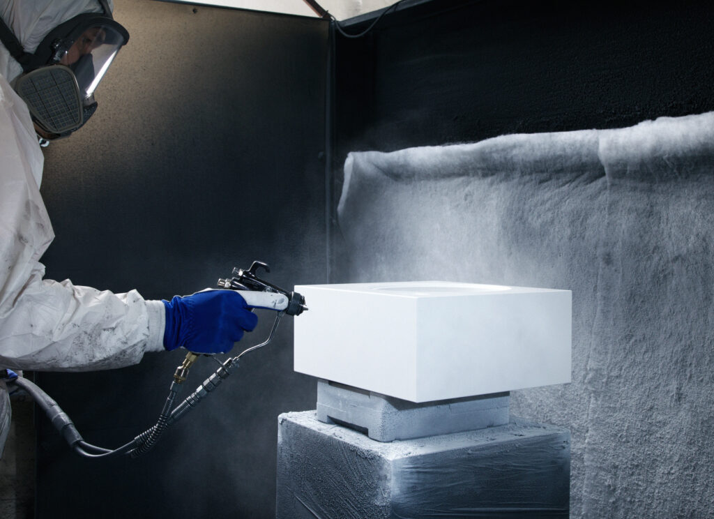 Artcustic speaker in the process of painting with a suit